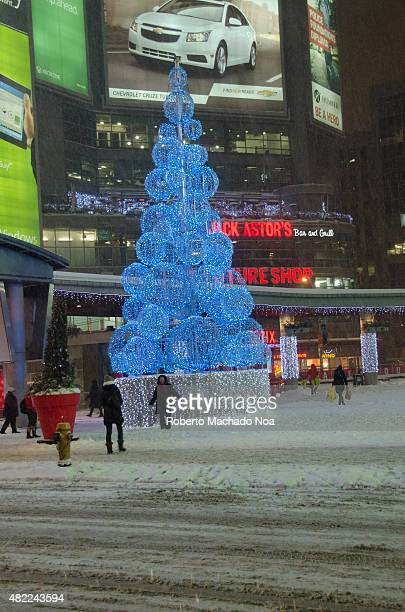Christmas tree in a YongeDundas Square in Toronto Modern shopping center in the background