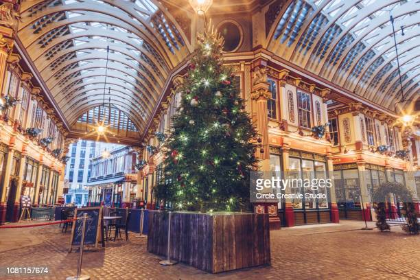 christmas tree in at the famous leadenhall market in london united kingdom - leadenhall market stock photos and pictures