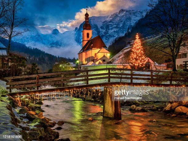 christmas tree in front of st sebastian's church at dusk with berchtesgaden alps in background, ramsau, bavaria, germany - german culture stock pictures, royalty-free photos & images