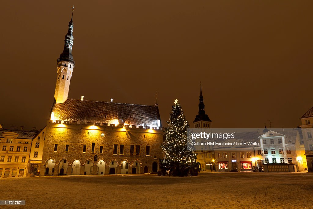 Christmas tree in snowy town square : Stock Photo