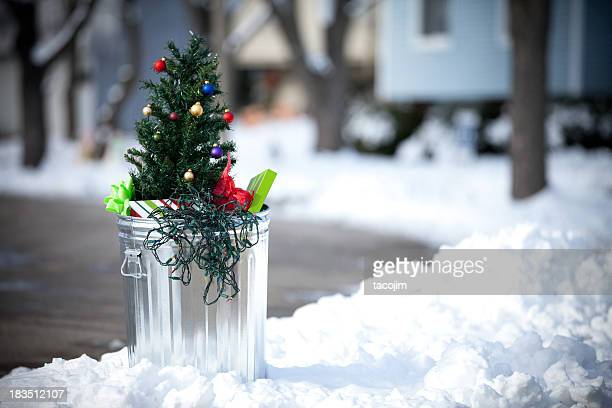 christmas tree in the garbage - obsolete stock pictures, royalty-free photos & images
