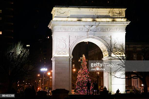 christmas tree in washington square park - washington square park stock pictures, royalty-free photos & images