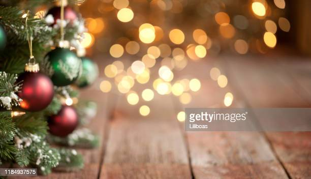 christmas tree intentionally defocused with gold lights background - country christmas stock pictures, royalty-free photos & images