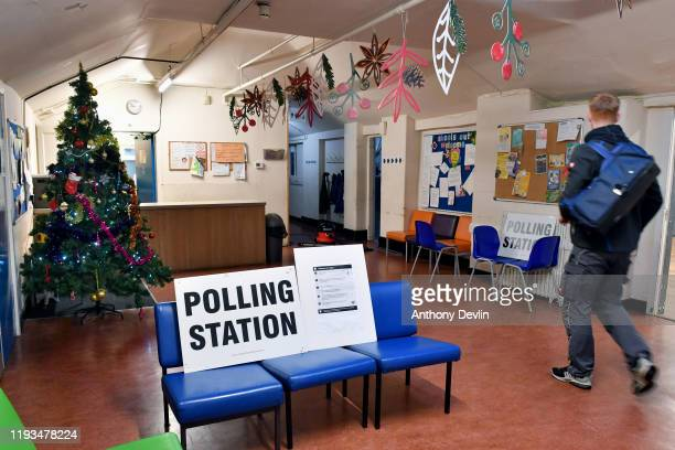 Christmas tree is displayed in the foyer beside the entrance to the polling station as voters arrive to cast their ballots at Roughtown Community...