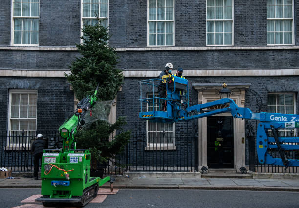 GBR: Downing Street Christmas Tree Is Put In Place For The Festive Season