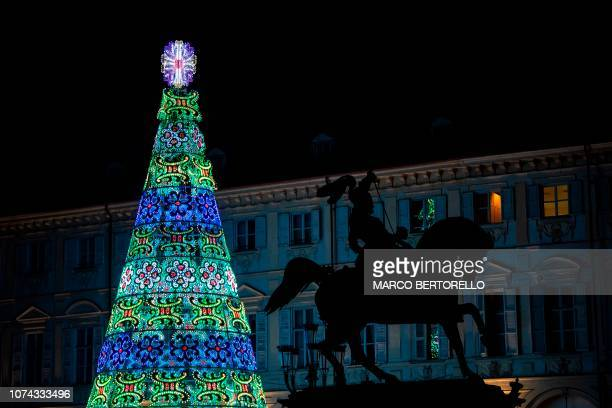 A Christmas tree is pictured near the equestrian statue of Emanuele Filiberto of Savoia in Piazza San Carlo in Turin on December 17 2018
