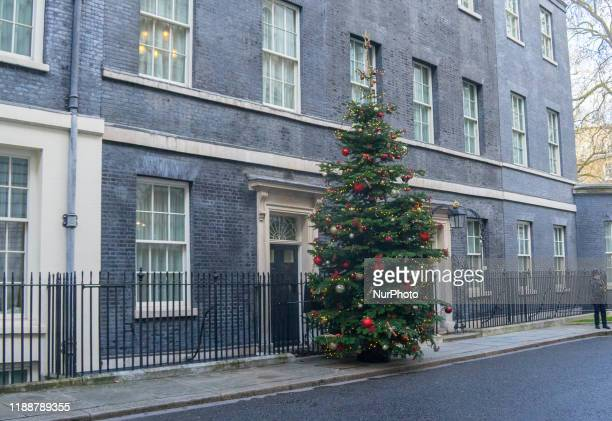 Christmas tree is pictured outside number 10 at Downing Street , in London , on 13 December 2019.