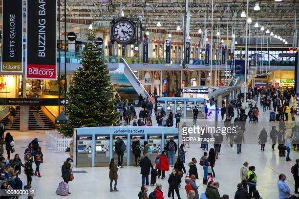 Christmas tree is seen at Waterloo railway station concourse in London with 21 days to Christmas day