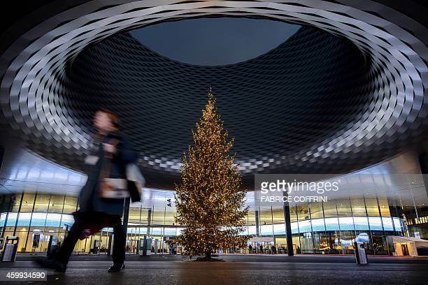 A Christmas tree is seen beneath the roof of the Messe Basel exhibition hall designed by Basel's architects Herzog de Meuron on December 4 2014 in...