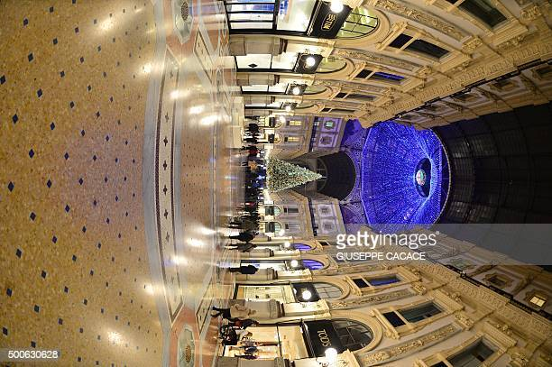A Christmas tree is set inside the Vittorio Emanuele gallery in Milan on December 9 2015 AFP PHOTO / GIUSEPPE CACACE / AFP / GIUSEPPE CACACE