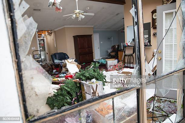 A Christmas tree lays in the wreckage of a family's home December 27 2015 in the aftermath of a tornado in Rowlett Texas At least 11 people lost...