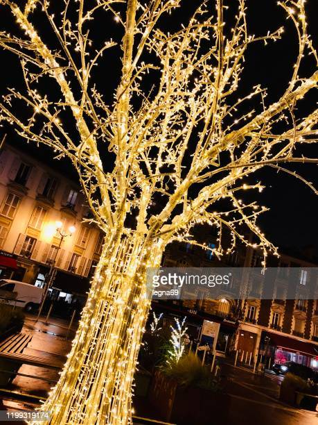christmas tree, light / glitter - montrouge hauts de seine stock pictures, royalty-free photos & images