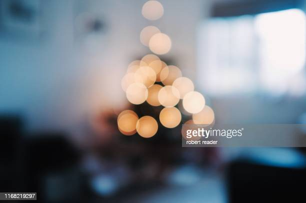 christmas tree lights - defocussed stock pictures, royalty-free photos & images