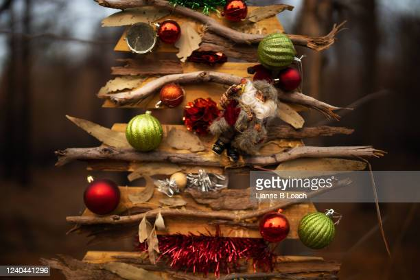 christmas tree made of bark and twigs decorated with baubles. - lianne loach stock pictures, royalty-free photos & images