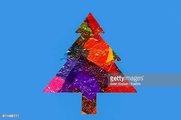Christmas Tree Made Of Multi Colored Plastic On Blue Background