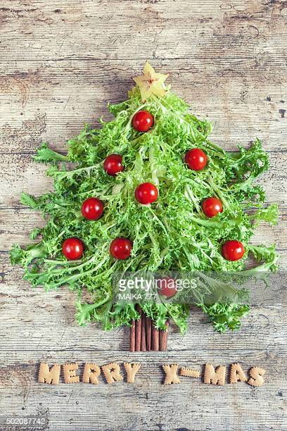 Christmas tree made with curly endive, cherry tomatoes and cinnamon sticks.