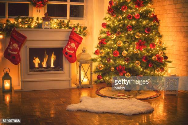 christmas tree near fireplace at home - christmas tree stock pictures, royalty-free photos & images