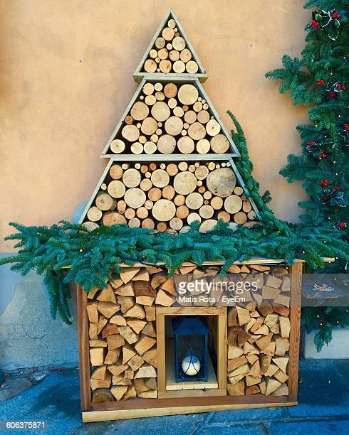 Christmas Tree Of Logs Against Wall