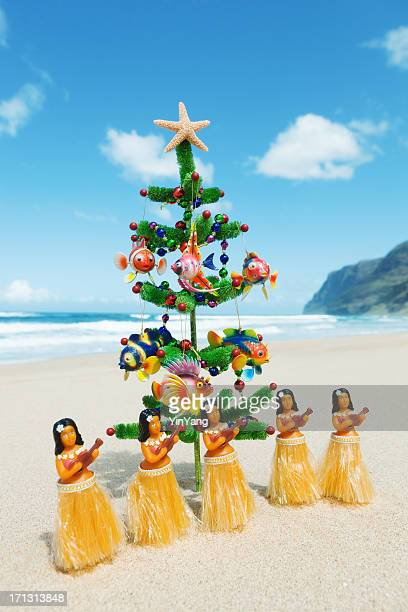 christmas tree on beach with hula dancers in hawaii - hawaii christmas stock pictures, royalty-free photos & images