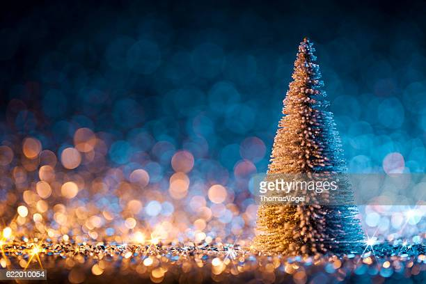 Christmas tree on defocused lights. Decorations Blue Gold
