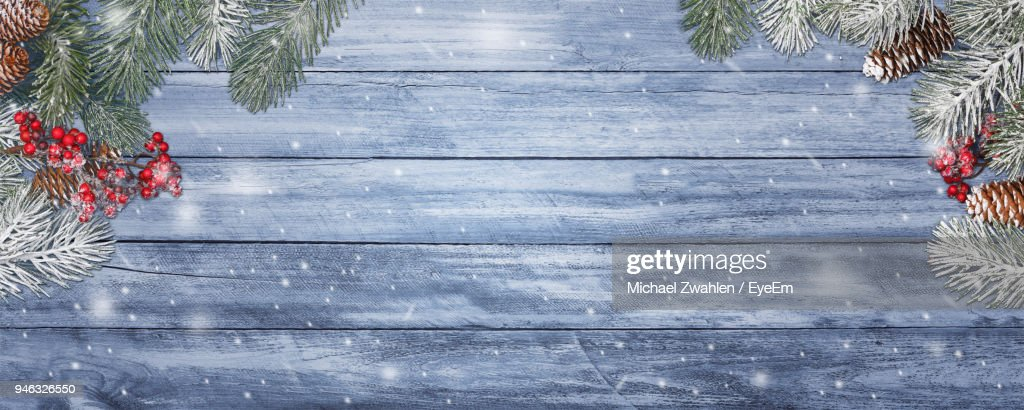 Christmas Tree On Wooden Table Against Wall : Stock Photo