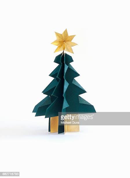 christmas tree origami on white background