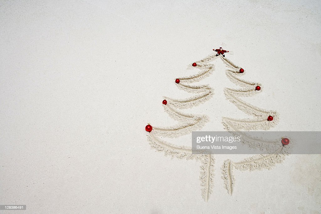 A Christmas Tree Outline Drawn In The Sand Stock Photo Getty Images