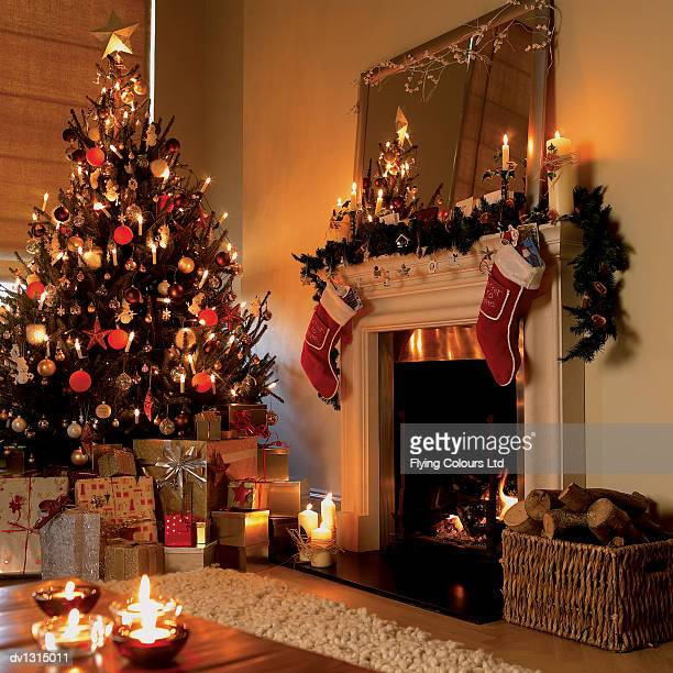 Christmas Tree, Presents, Christmas Decorations and An Open Fire in a Living Room