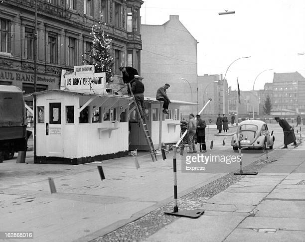 Christmas Tree put on top of Checkpoint Charlie in Berlin 12/20/62