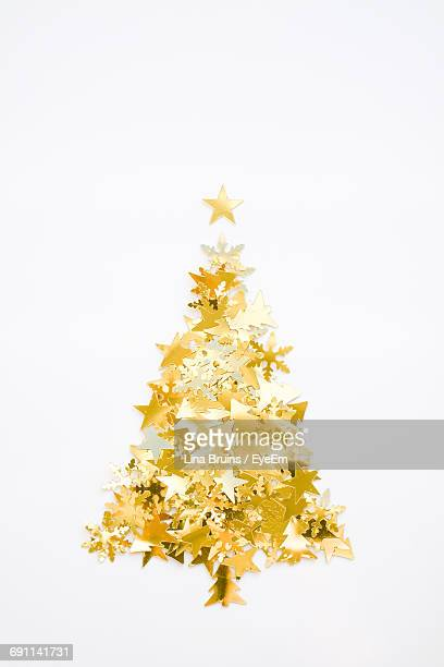 Christmas Tree Shape Confetti Against White Background