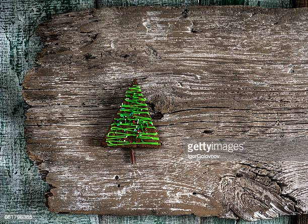 Christmas tree shaped cake on wooden plank
