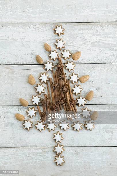 Christmas tree shaped of cinnamon stars, cinnamon sticks, almonds and star anise
