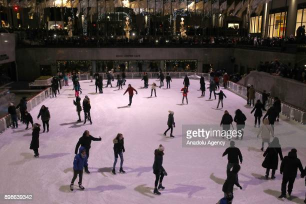 Christmas Tree shines over the iceskating people at Bryant Park in New York City USA on December 26 2017
