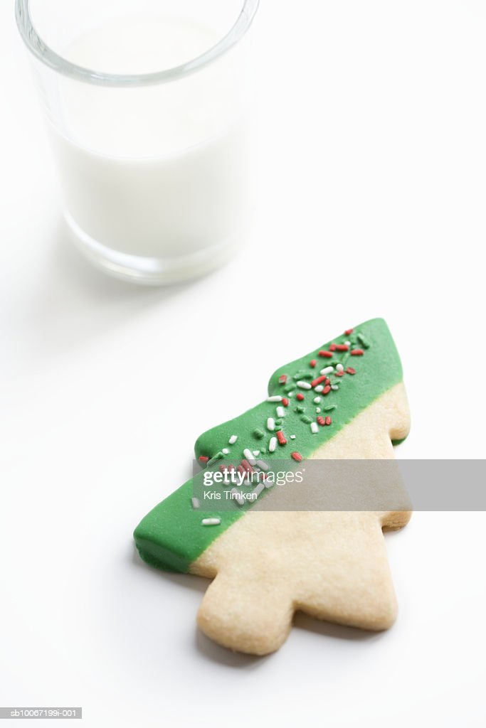 Christmas Tree Shortbread Cookie With Glass Of Milk Stock Photo