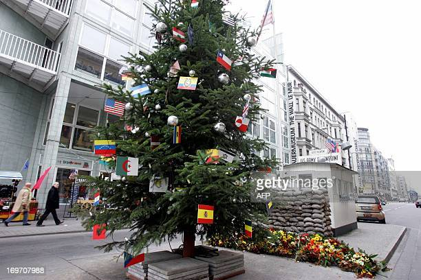 A christmas tree stands at Berlin's famed Checkpoint Charlie where Russian and US soldiers faced each other during the cold war 01 December 2004 The...