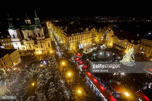 A christmas tree stands at the Christmas market at the Old Town Square on December 1 2013 in Prague Czech Republic Christmas markets traditionally...