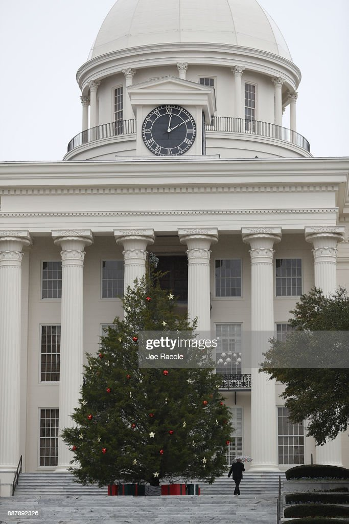 A Christmas tree stands in front of the Capitol building as Alabama prepares to head to the polls on Tuesday on December 7, 2017 in Montgomery, Alabama. Democratic Senatorial candidate Doug Jones is facing off against Republican Roy Moore in next week's special election for the U.S. Senate.