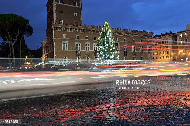 A Christmas tree stands in Piazza Venezia central Rome on December 20 2013 AFP PHOTO / GABRIEL BOUYS