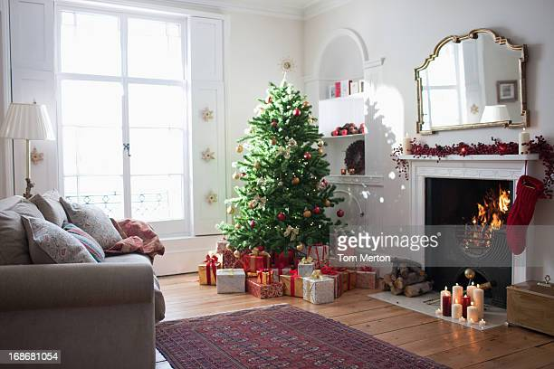 christmas tree surrounded with gifts - ornate stock pictures, royalty-free photos & images