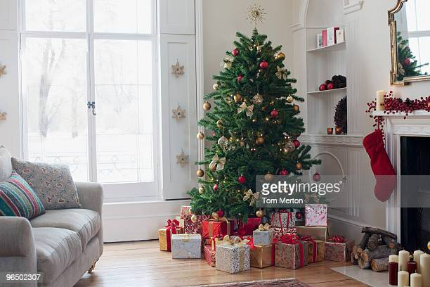 christmas tree surrounded with gifts - christmas tree stock pictures, royalty-free photos & images