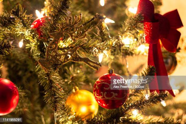 christmas tree with garlands - christmas background stock photos and pictures