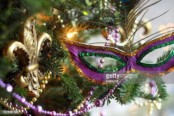 Christmas tree with Mardi Gras masks on it