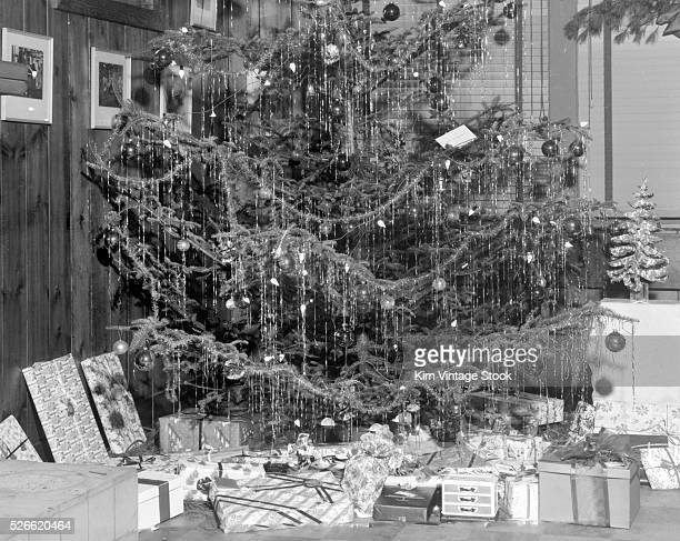 Christmas tree with presents, ca. 1950.