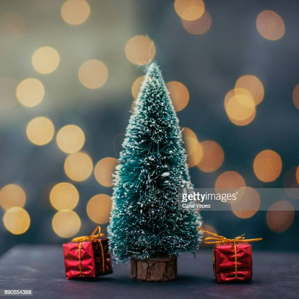 christmas tree with red gifts.Glow dark background