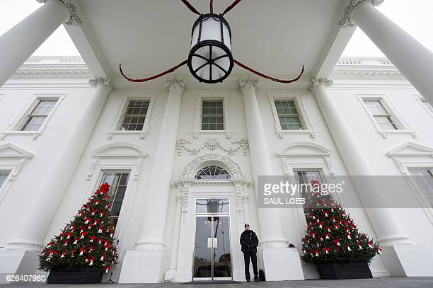 Christmas trees and holiday decorations in the theme of The Gift of the Holidays are seen at the North Portico of the White House in Washington DC...