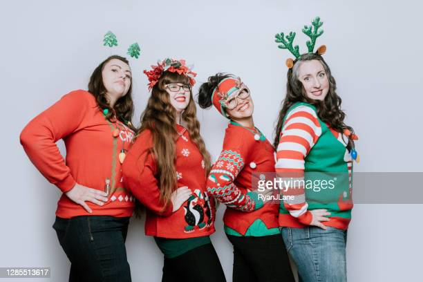 christmas ugly sweater party with adult friends - ugly christmas sweater party stock pictures, royalty-free photos & images