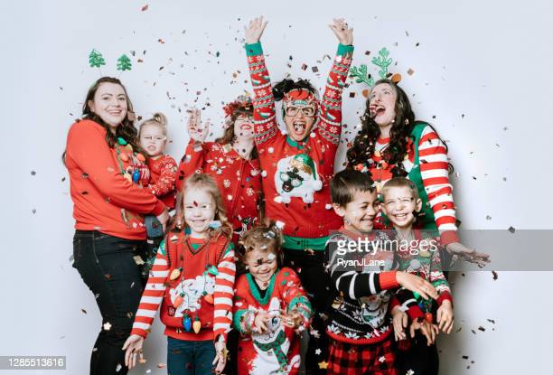 christmas ugly sweater party with families - ugly christmas sweater party stock pictures, royalty-free photos & images
