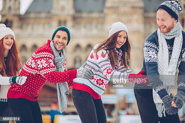christmas vacation with friends - town hall square stock pictures, royalty-free photos & images