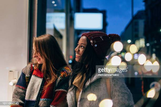 christmas window shopping - winter coat stock pictures, royalty-free photos & images