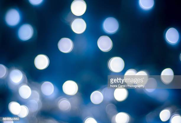 christmas winter bokeh light blue tones background - spotted stock pictures, royalty-free photos & images